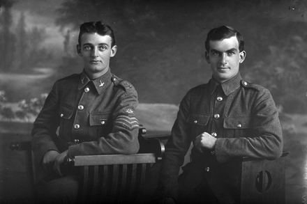 3/4 portrait of cousins Private 'Driver' Dudley Hancock Doidge 12760 3rd NZDAC, NZFA (right) who embarked with the 13th reinforcements NZFA 27 May 1916, and Sergeant Herbert Doidge 40528 (left), in the uniform of the 16th Waikato, but who embarked as a private with the 23rd reinforcements, A coy, Auckland infantry regiment on 14 March 1917 (Photographer: Herman Schmidt, 1916). Sir George Grey Special Collections, Auckland Libraries, 31-D406. No known copyright.