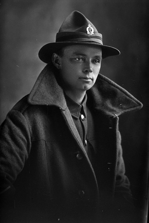 1/2 length portrait of Lance Corporal Leonard Booker, Reg No 55173, New Zealand Medical Corps. (Photographer: Herman Schmidt, ). Sir George Grey Special Collections, Auckland Libraries, 31-B3568. No known copyright.