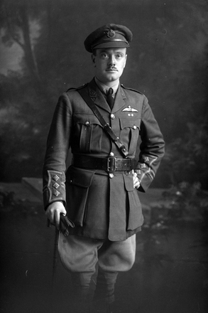 3/4 portrait of Captain Blayney of the Royal Flying Corps, probably from the Walsh Brothers' New Zealand Flying School at Kohimarama, Auckland, wearing a Military Cross ribbon below RFC wings. B  [ls:35043] (Photographer: Herman Schmidt, ). Sir George Grey Special Collections, Auckland Libraries, 31-B4070. No known copyright.