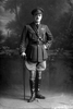 Full length portrait of Captain Blayney of the Royal Flying Corps, probably from the Walsh Brothers' New Zealand Flying School at Kohimarama, Auckland. (Photographer: Herman Schmidt, ). Sir George Grey Special Collections, Auckland Libraries, 31-B4074. No known copyright.