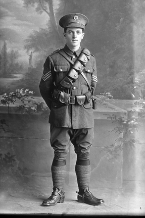 Full length portrait of Sergeant McCabe  [possibly 13/3055 George Leo McCabe] (Photographer: Herman Schmidt, 1916). Sir George Grey Special Collections, Auckland Libraries, 31-C181. No known copyright.