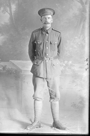 Full length portrait of Sapper William Coldicutt, Reg No 4/1244 of the New Zealand Tunnelling Company. (Photographer: Herman Schmidt, 1915). Sir George Grey Special Collections, Auckland Libraries, 31-C274. No known copyright.