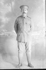 Full length portrait of Sapper Oswald Charles Cossey, Reg No 4/1251 of the New Zealand Tunnelling Company (Photographer: Herman Schmidt, 1915). Sir George Grey Special Collections, Auckland Libraries, 31-C304. No known copyright.