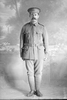 Full length portrait of Sapper Oswald Charles Cossey, Reg No 4/1251 of the New Zealand Tunnelling Company (Photographer: Herman Schmidt, 1915). Sir George Grey Special Collections, Auckland Libraries, 31-C308. No known copyright.