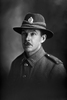 1/4 portrait of Lance Corporal Henry Richard Cowan, Reg No. 23322, of the 7th Reinforcements to the 1st Battalion, - E Company, New Zealand Rifle Brigade. (Photographer: Herman Schmidt, 1916). Sir George Grey Special Collections, Auckland Libraries, 31-C322. No known copyright.