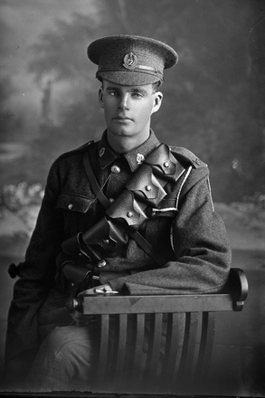 3/4 portrait of Alfred Sydney Corbett, Reg No 10322, of the Wellington Infantry Battalion, - J Company, 12th Reinforcements. Killed in action in France on 15 November 1916. (Photographer: Herman Schmidt, 1916). Sir George Grey Special Collections, Auckland Libraries, 31-C1522. No known copyright.