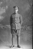 Full length portrait of Private Thomas Brownlee Clark, Reg No 38349, of the Auckland Infantry Regiment, - A Company, 22nd Reinforcements. (Photographer: Herman Schmidt, 1917). Sir George Grey Special Collections, Auckland Libraries, 31-C2228. No known copyright.