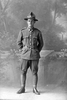 Full length portrait of Private Noel Johnston Campbell, Reg No 33641, of the Specialist Company, Signal Section, 22nd Reinforcements. (Photographer: Herman Schmidt, 1917). Sir George Grey Special Collections, Auckland Libraries, 31-C2262. No known copyright.