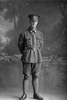 Full length portrait of Corporal William Carson, Reg No 34471,  of the 20th Reinforcements, E Company. Killed in action in France, 2 July 1917. (Photographer: Herman Schmidt, 1916). Sir George Grey Special Collections, Auckland Libraries, 31-C2267. No known copyright.