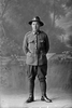 Full length portrait of Trooper Stanley Martyn Barriball, Reg No 43180, New Zealand Mounted Rifles, 26th Reinforcements. (Photographer: Herman Schmidt, 1917). Sir George Grey Special Collections, Auckland Libraries, 31-B3041. No known copyright.