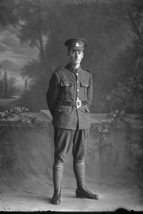 """Full length portrait of Private John Conyngham of the New Zealand Rifle Brigade, Serial No 52730 NZ Rifle Brigade Reinforcements, G Company. Left for Devonport, England aboard HMNZT 86 or 87 """"Maunganui"""" or """"Tahiti"""". He died of wounds on 10 Sep 1918 in Somme, France and is buried at the Euston Road Cemetery, Collincamps Grave Ref 11.F.2. He was the son of John Conyngham and Annie Susanna (nee Cleary) of 125 Crummer Road, Grey Lynn, Auckland and another son Arthur James also served in the war returning unlike his brother   (Photographer: Herman Schmidt, 1917). Sir George Grey Special Collections, Auckland Libraries, 31-C3074. No known copyright."""