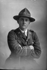 3/4 portrait of 2nd Lieutenant Andrew Leonard Caughy, Reg No 38829, of the Auckland Infantry Regiment, - A Company, 29th Reinforcements (Cap badge is 25th R. but collar badges are 29th R). (Photographer: Herman Schmidt, 1917). Sir George Grey Special Collections, Auckland Libraries, 31-C3616. No known copyright.