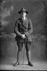 Full length portrait of 2nd Lieutenant Andrew Leonard Caughy, Reg No 38829, of the Auckland Infantry Regiment, - A Company, 29th Reinforcements (Cap badge is 25th R. but collar badges are 29th R). (Photographer: Herman Schmidt, 1917). Sir George Grey Special Collections, Auckland Libraries, 31-C3617. No known copyright.