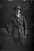 3/4 portrait of 2nd Lieutenant Andrew Leonard Caughy, Reg No 38829, of the Auckland Infantry Regiment, - A Company, 29th Reinforcements (Cap badge is 25th R. but collar badges are 29th R). (Photographer: Herman Schmidt, 1917). Sir George Grey Special Collections, Auckland Libraries, 31-C3619. No known copyright.