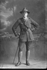 Full length portrait of 2nd Lieutenant Andrew Leonard Caughy, Reg No 38829, of the Auckland Infantry Regiment, - A Company, 29th Reinforcements (Cap badge is 25th R. but collar badges are 29th R). (Photographer: Herman Schmidt, 1917). Sir George Grey Special Collections, Auckland Libraries, 31-C3621. No known copyright.