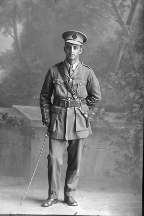 Full length portrait of 2nd Lieutenant George Robert Dansey, Reg No 33004, of the Maori Contingent, 14th Reinforcements. New Zealand Maori Pioneer Battalion. (Photographer: Herman Schmidt, 1917). Sir George Grey Special Collections, Auckland Libraries, 31-D2737. No known copyright.