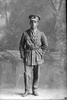Full length portrait of 2nd Lieutenant George Robert Dansey, Reg No 33004, of the Maori Contingent, 14th Reinforcements. New Zealand Maori Pioneer Battalion (Photographer: Herman Schmidt, 1917). Sir George Grey Special Collections, Auckland Libraries, 31-D2739. No known copyright.