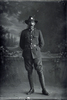 Full length portrait of Private John Stanley Daubeny, Reg No 52387, of the 27th Reinforcements, E Company. (Photographer: Herman Schmidt, 1917). Sir George Grey Special Collections, Auckland Libraries, 31-D3081. No known copyright.