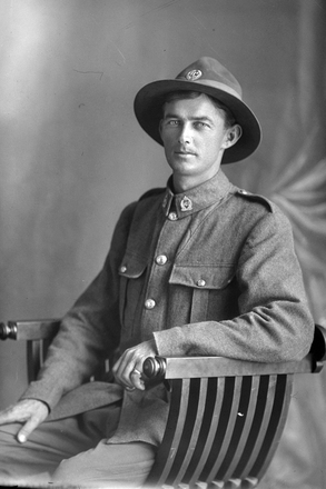 3/4 portrait of Private Richard Oliver Daly, Reg No 73242, of the 37th Reinforcements, B Company (Photographer: Herman Schmidt, 1918). Sir George Grey Special Collections, Auckland Libraries, 31-D3658. No known copyright.
