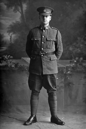 Full length portrait of Private Vivian Leonard Gittos, Reg No 3/2509, of the New Zealand Medical Corps. (Photographer: Herman Schmidt, 1916). Sir George Grey Special Collections, Auckland Libraries, 31-G2360. No known copyright.