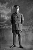 Full length portrait of Corporal Gallagher of the 22nd Reinforcements. An Auckland Rugby Union catalogue from 1918 identifies him as Dave Gallaher, captain of the famous All Blacks. Died of wounds in France on 4 October 1917, at the battle of Passchendaele (Photographer: Herman Schmidt, 1917). Sir George Grey Special Collections, Auckland Libraries, 31-G2778. No known copyright.
