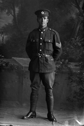 Full portrait of Sergeant Harvey, probably Sergeant Reginald Charles Harvey, Reg no. 48639, Auckland Infantry Regiment - A Company, 26th Reinforcements (Photographer: Herman Schmidt, 1917). Sir George Grey Special Collections, Auckland Libraries, 31-H3150. No known copyright.