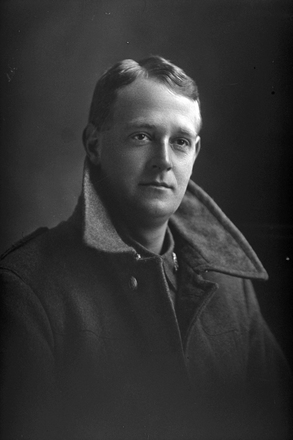 1/4 portrait of Private Hartland, 29th Reinforcements (possibly John Leslie Hartland, Reg no. 56592, E Company - 29th Reinforcements), wearing greatcoat (Photographer: Herman Schmidt, 1917|1918). Sir George Grey Special Collections, Auckland Libraries, 31-H3740. No known copyright.
