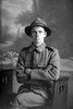 3/4 portrait of Private H (possibly K) McKenzie of the New Zealand Rifle Brigade, 9th Reinforcements. (Photographer: Herman Schmidt, 1916). Sir George Grey Special Collections, Auckland Libraries, 31-K1688. No known copyright.