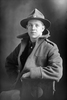 1/4 portrait of Private Arthur Alston (Joe) Gribbin, Reg No 78475, of the New Zealand Medical Corps. (Photographer: Herman Schmidt, 1918). Sir George Grey Special Collections, Auckland Libraries, 31-G4276. No known copyright.