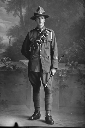 Full length portrait of Gunner Arthur Bramwell Hudson, Reg No 2/2844, of the New Zealand Field Artillery, No. 5 Field Battery (2nd Field Artillery Brigade). (Photographer: Herman Schmidt, ). Sir George Grey Special Collections, Auckland Libraries, 31.H650. No known copyright.