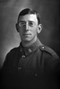 1/4 portrait of Private Robin Hamley, Reg No 31636, of the Auckland Infantry Battalion, - A Company, 19th Reinforcements. Died of wounds in France on 6 October 1917. (Photographer: Herman Schmidt, 1916). Sir George Grey Special Collections, Auckland Libraries, 31-H2012. No known copyright.