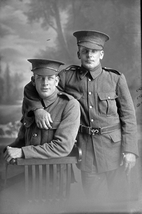 3/4 group portrait of the Leith brothers, Sapper David Alexander Leith, Reg No 4/1661, and Sapper James Charles Leith, Reg No 4/1290, both with the New Zealand Tunnelling Company. (Photographer: Herman Schmidt, 1915). Sir George Grey Special Collections, Auckland Libraries, 31-L688. No known copyright.