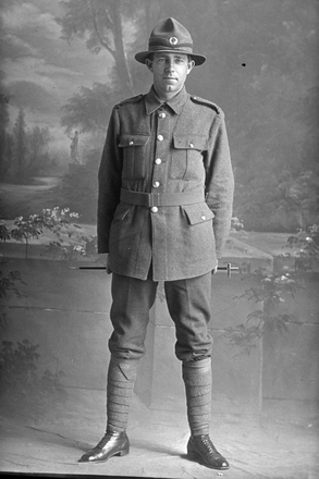 Full length portrait of Private James Duncan McLeod, Reg No 12/3761, of the Auckland Infantry Battalion, - A Company, 9th Reinforcements. (Photographer: Herman Schmidt, 1916). Sir George Grey Special Collections, Auckland Libraries, 31-L702. No known copyright.