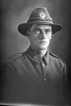 1/4 portrait of Private Ernest Henry Lister, Reg No 24475, of the Otago Infantry Battalion, - D Company, 16th Reinforcements. (Photographer: Herman Schmidt, 1916). Sir George Grey Special Collections, Auckland Libraries, 31-L1750. No known copyright.