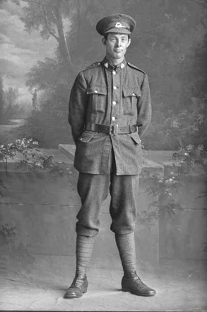 Full length portrait of Private William Lee, Reg No 30820, of the Auckland Infantry Battalion, - A Company, 20th Reinforcements. (Photographer: Herman Schmidt, 1916). Sir George Grey Special Collections, Auckland Libraries, 31-L2843. No known copyright.