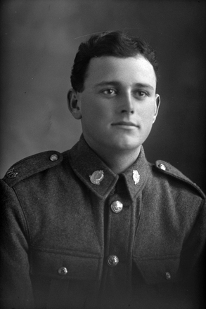 1/4 portrait of Private Arthur Maddock, Reg No 14467, of the Auckland Infantry Regiment, - A Company, 14th Reinforcements. (Photographer: Herman Schmidt, 1916). Sir George Grey Special Collections, Auckland Libraries, 31-M738. No known copyright.
