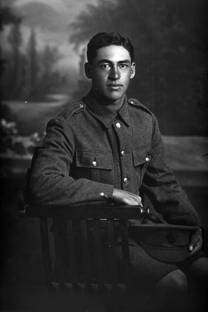 3/4 portrait of W Mapu, probably Corporal Waitaringa Mapu, Reg No 16/1471, of the New Zealand Maori Pioneer Battalion, 4th Maori Contingent. (Photographer: Herman Schmidt, 1916). Sir George Grey Special Collections, Auckland Libraries, 31-M748. No known copyright.