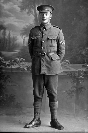 Full length portrait of Corporal Mays, possibly Arthur Augustus Mays, Reg No 17/349, of the 8th Reinforcements, New Zealand Veterinary Corps. (Photographer: Herman Schmidt, 1915). Sir George Grey Special Collections, Auckland Libraries, 31-M776. No known copyright.