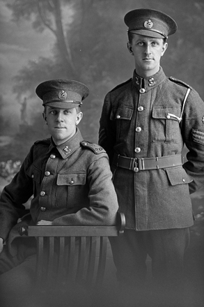 3/4 portrait of 2 men of the 3rd (Auckland) Regiment, Auckland Infantry Regiment, one a private and the other is Quartermaster Sergeant Arnold Edgar Mills, Reg No 13/3732, A Company. Killed in action in France on 7 July 1916. (Photographer: Herman Schmidt, 1915|1916). Sir George Grey Special Collections, Auckland Libraries, 31-M811. No known copyright.