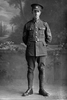 Full length portrait of Quartermaster Sergeant Arnold Edgar Mills, Reg No 13/3732, 3rd (Auckland) Regiment, Auckland Infantry Regiment, - A Company. Killed in action in France on 7 July 1916. (Photographer: Herman Schmidt, 1915|1916). Sir George Grey Special Collections, Auckland Libraries, 31-M814. No known copyright.