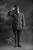 Full length portrait of Lieutenant Herbert Albert Edwin Milnes, Reg No 22525, of the 3rd (Auckland) Regiment, Auckland Infantry Regiment, Ships Adjutant of the 21st Reinforcements, Headquarters Staff. Killed in action in France on the 4th October 1917 at the Battle of Passchendaele. (Photographer: Herman Schmidt, 1916). Sir George Grey Special Collections, Auckland Libraries, 31-M2344. No known copyright.