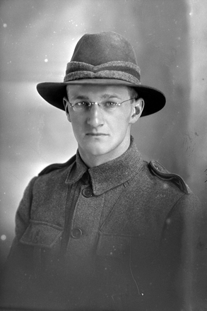 1/4 portrait of Private Pirritt (?) of the New Zealand Medical Corps, possibly William Deans Pirrett, Reg No 3/2690, or John Cameron Pirrit, Reg No 3/1789. (Photographer: Herman Schmidt, 1916). Sir George Grey Special Collections, Auckland Libraries, 31-P911. No known copyright.