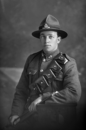 3/4 portrait of Gunner Archibald Cyril Philpot, Reg No 17321, of the New Zealand Field Artillery. (Photographer: Herman Schmidt, 1916). Sir George Grey Special Collections, Auckland Libraries, 31-P2420. No known copyright.