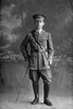 Full length portrait of 2nd Lieutenant Martin Driscoll Rohan, Reg No 27692, of the New Zealand Rifle Brigade, 10th Reinforcements to the 3rd Battalion, - G Company. (Later T/Captain). Killed in action in France on the 22nd August 1918, Mentioned in Despatches. (Photographer: Herman Schmidt, 1916). Sir George Grey Special Collections, Auckland Libraries, 31-R2451. No known copyright.