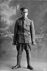 Full length portrait of Private Charles Haddon Simpkin, Reg No 23/2281, of the New Zealand Rifle Brigade, 5th Reinforcements to the 1st Battalion, - E Company. Died of wounds in France on 19 January 1918. (Photographer: Herman Schmidt, 1915|1916). Sir George Grey Special Collections, Auckland Libraries, 31-S1049. No known copyright.