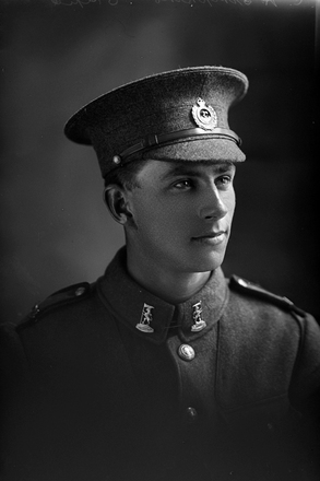 1/4 portrait of Private Charles Haddon Simpkin, Reg No 23/2281, of the New Zealand Rifle Brigade, 5th Reinforcements to the 1st Battalion, - E Company. Died of wounds in France on 19 January 1918. (Photographer: Herman Schmidt, 1915|1916). Sir George Grey Special Collections, Auckland Libraries, 31-S1051. No known copyright.