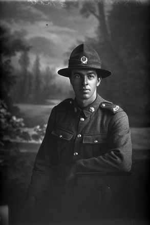 3/4 portrait of Private N Smeed, of the 11th Reinforcements, Auckland Infantry Battalion, - A Company. Possibly Private Norman Smeed, Reg No 11548, in the nominal roll with the 12th Reinforcements. Killed in action in France on 7 June 1917 at the Battle of Messines. (Photographer: Herman Schmidt, 1916). Sir George Grey Special Collections, Auckland Libraries, 31-S1093. No known copyright.