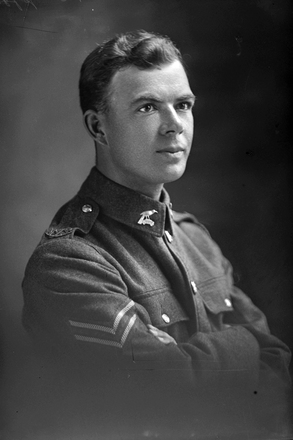 1/4 portrait of Corporal Sinel, probably Wilfred Courtney Sinel. (Photographer: Herman Schmidt, 1917). Sir George Grey Special Collections, Auckland Libraries, 31-S2512. No known copyright.
