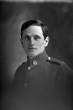 1/4 portrait of Rifleman Charles Simson, Reg No 29501, of the New Zealand Rifle Brigade, 12th Reinforcements to the 1st Battalion, - E Company. Died of wounds in the UK from France on 4 July 1917. (Photographer: Herman Schmidt, 1916). Sir George Grey Special Collections, Auckland Libraries, 31-S2516. No known copyright.