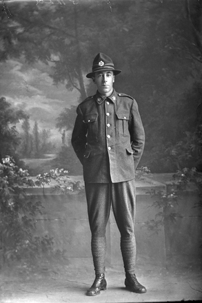 Full length portrait of Private Allan Speir of the 27th Reinforcements, Reg No 49124. (Photographer: Herman Schmidt, 1917). Sir George Grey Special Collections, Auckland Libraries, 31-S3478. No known copyright.